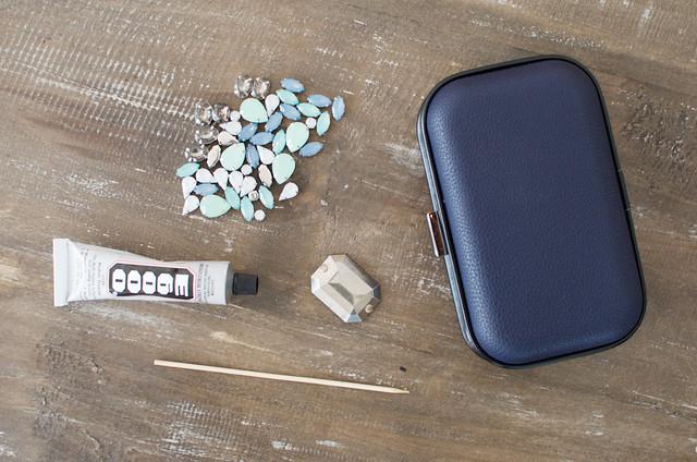 Make a jeweled clutch www.apairandasparediy.com