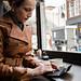 Gemini PDA keyboard mobile device in use in a coffee shop