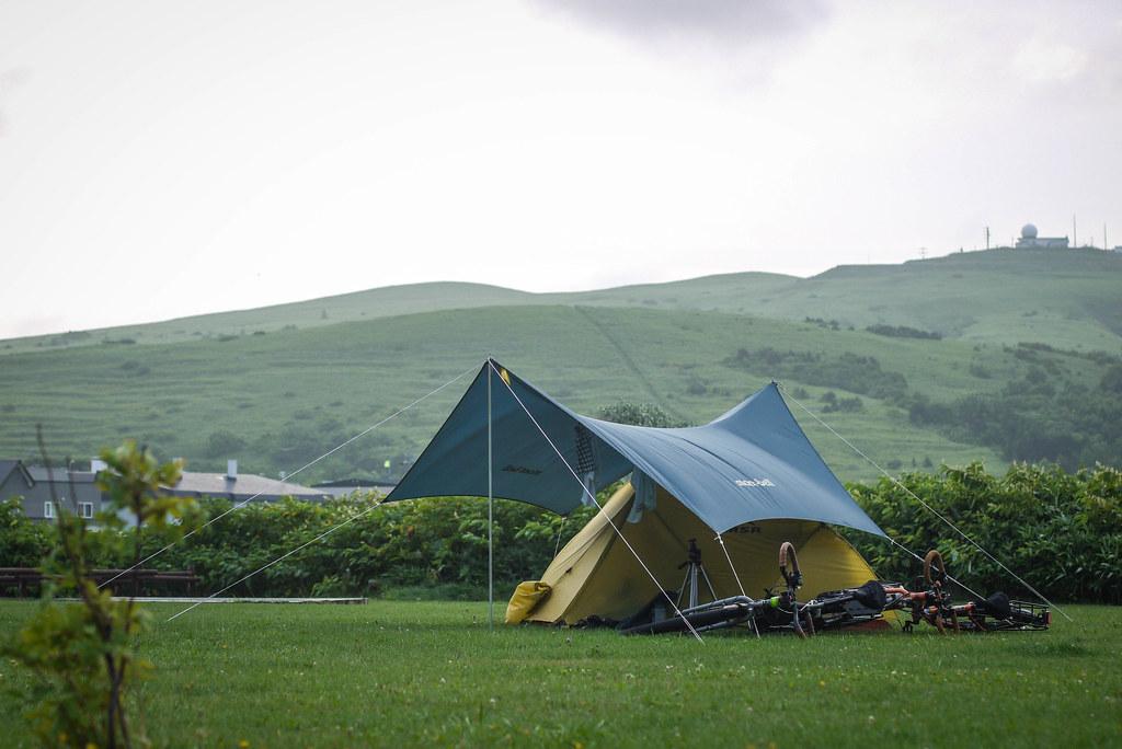 Tent and tarp at the Kushuko-han Campground at the north of Rebun Island, Hokkaido, Japan
