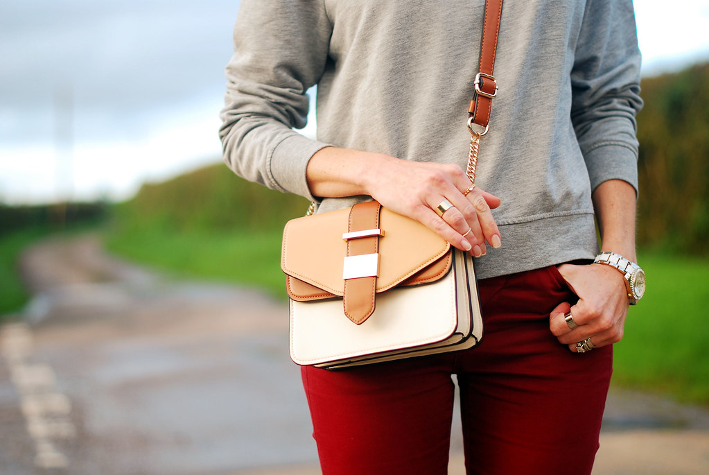 Grey sweatshirt, cross body colour blocked bag & red skinnies