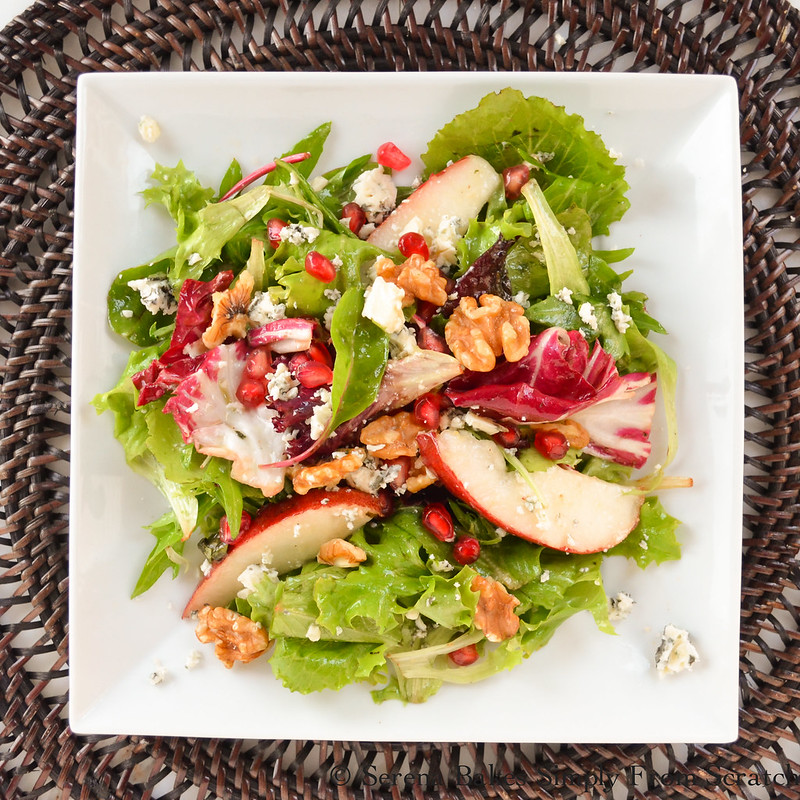 Serve salad and sprinkle with pomegranate seeds and walnuts.