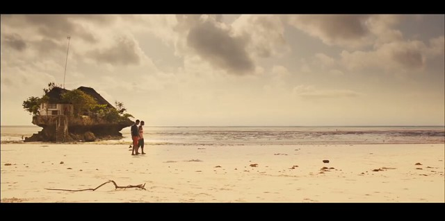 A still from Jonah of two guys walking on the beach