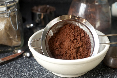 sifting dark cocoa powder