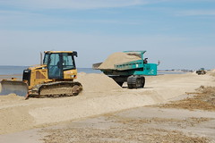 PHOTO: Specialized earth-movers deposit thousands of tons of sand at Reeds Beach on New Jersey's Delaware Bay.