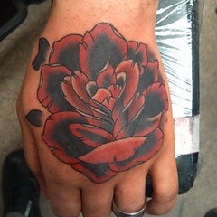 Custom rose tattoo I did yesterday on a client's hand. I have some openings Saturday afternoon, if anyone is interested in getting tattooed, shoot me a text to 202-644-3041. #tattoos #bobbyrotten #laughinghyena #traditional #rose #hand #tattooartist