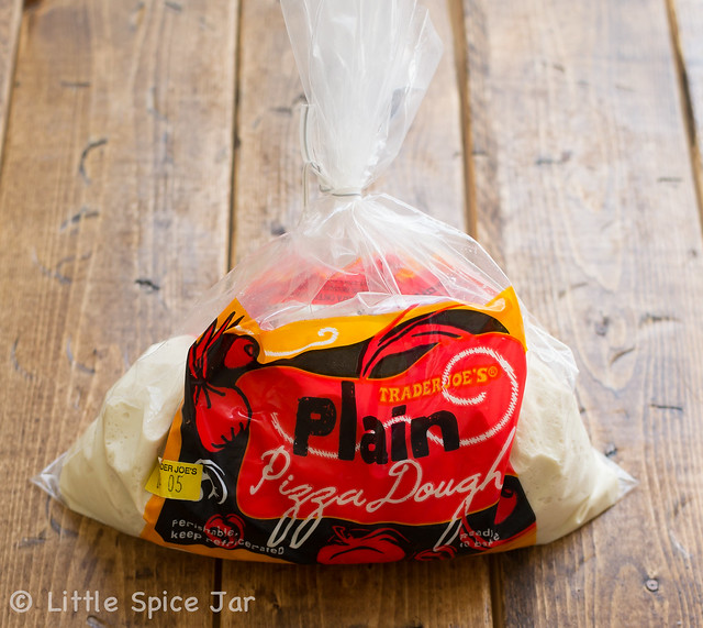 bag of store bought pizza dough on wood surface