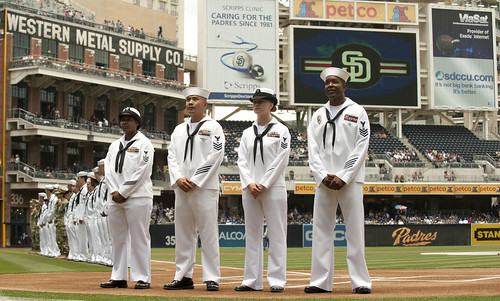 Sailors take the field during a Navy Appreciation Day