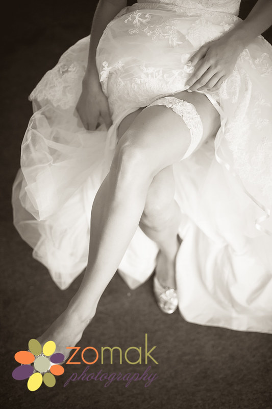 sexy shot of the bride's garter and shoes