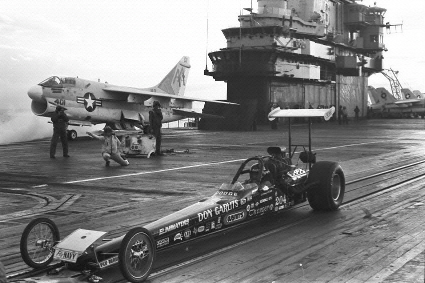 Circa 1972:  Don Garlits' drag racer on the flight deck of the USS Lexington