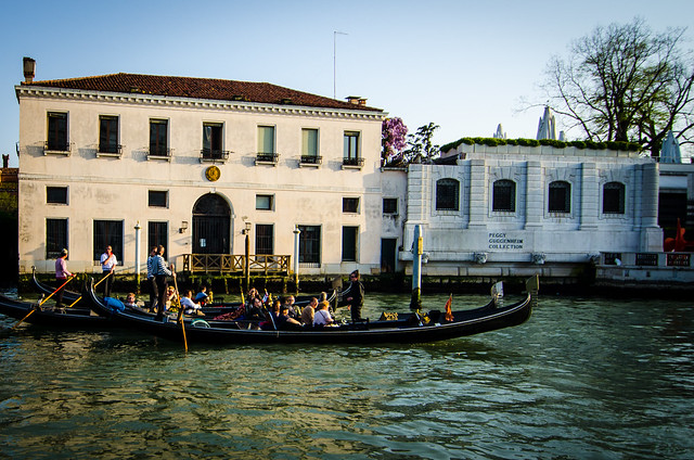 Gondolas float past the Peggy Guggenheim museum on a tour of the Grand Canal.