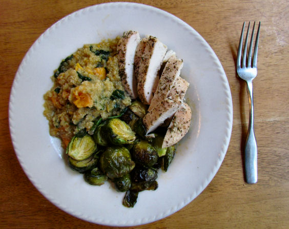 Quinoa bowl with roasted chicken and Brussels sprouts