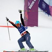 Marielle Thompson crosses the finish line first in Sochi, Russia at the 2014 Winter Olympics
