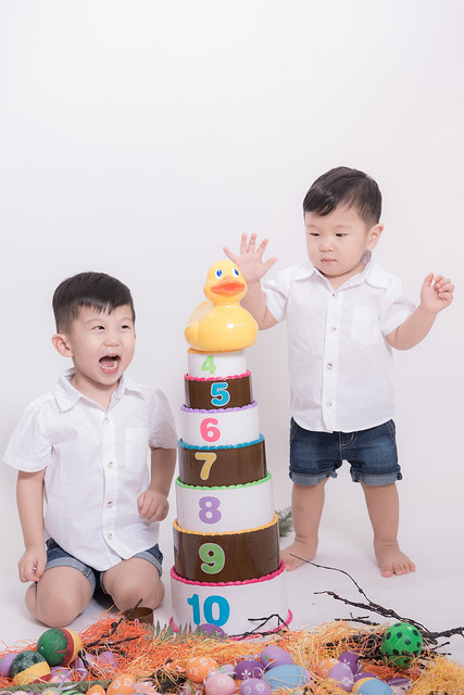 Jerome choo and jerry choo playing stacking up toys.