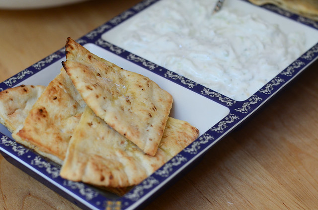 A serving of Toasted Pitas with Tzatziki Sauce.