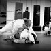 <p>Brandon Winfrey and a few of his colleagues rolling at their gym, Ozark Mountain Jiu Jitsu in Marshfield, Missouri. Here he is working for a 180 armbar.</p>