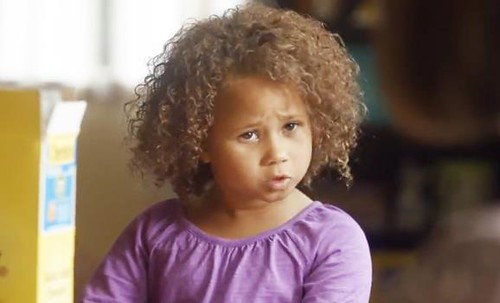 An adorable multiracial girl in a cheerios commerical