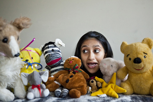 Aparna Nancherla surrounded by stuffed animals