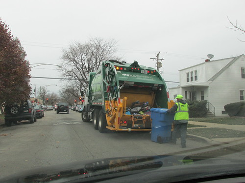 Waste Management trash collection in progress.  Chicago Illinois.  Late November 2013. by Eddie from Chicago