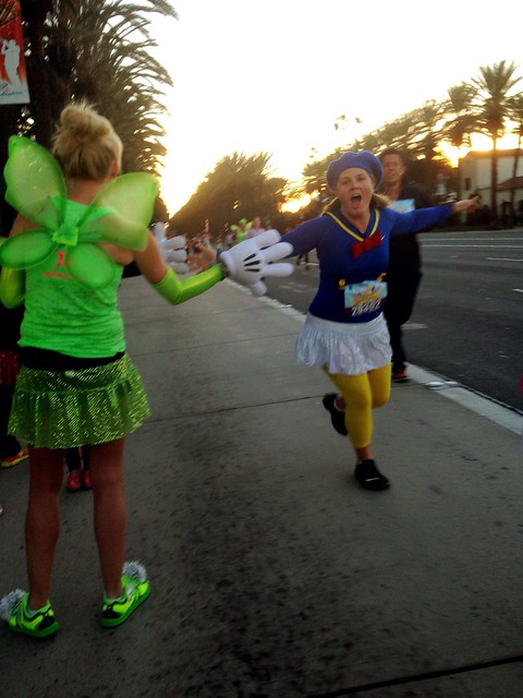 High-fiving @according2kelly and the rest of @sparkleathletic gals on the way to the finish!