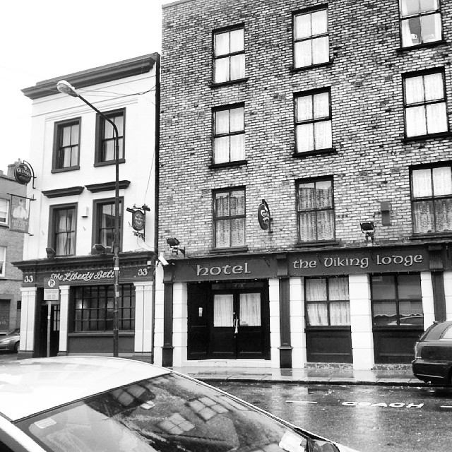 A bit of Francis St. In Dublin. The Liberty Belle pub next to the Viking Lodge and hotel. I am not sure but I think Vikings were not likely to support liberty or bells for that matter... oh and it is still raining. #dublin #ireland #architecture #humor #w