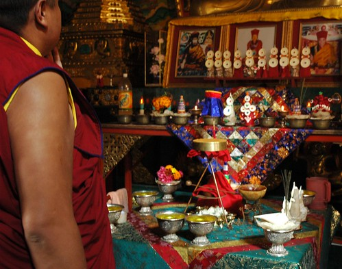 Tibetan Buddhist monk looking at the torma offerings for Vajrayogini initiation, shrine room, Sakya Lamdre, Tharlam Monastery of Tibetan Buddhism, Boudha, Kathmandu, Nepal by Wonderlane