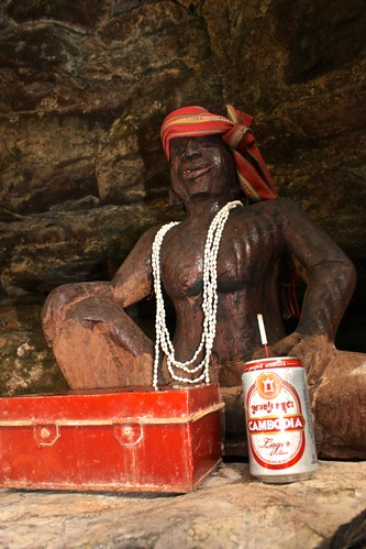 a local tribe creates a figure of the likeness of a person who dies, decorating it with things that person liked… This guy obviously liked beer