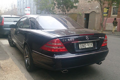 mercedes-benz clk-class(0.0), mercedes-benz slk-class(0.0), automobile(1.0), automotive exterior(1.0), wheel(1.0), vehicle(1.0), mercedes-benz(1.0), mercedes-benz cl-class(1.0), bumper(1.0), mercedes-benz e-class(1.0), sedan(1.0), land vehicle(1.0), luxury vehicle(1.0), vehicle registration plate(1.0), coupã©(1.0),