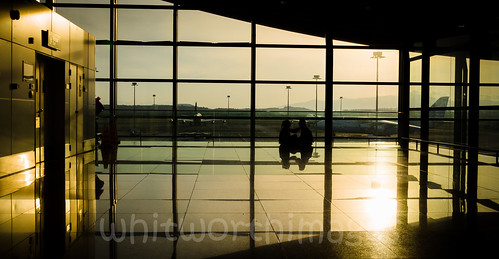 light shadow two people sun building window silhouette sunrise dawn airport couple pattern sitting terminal indoors malaysia inside kualalumpur outline