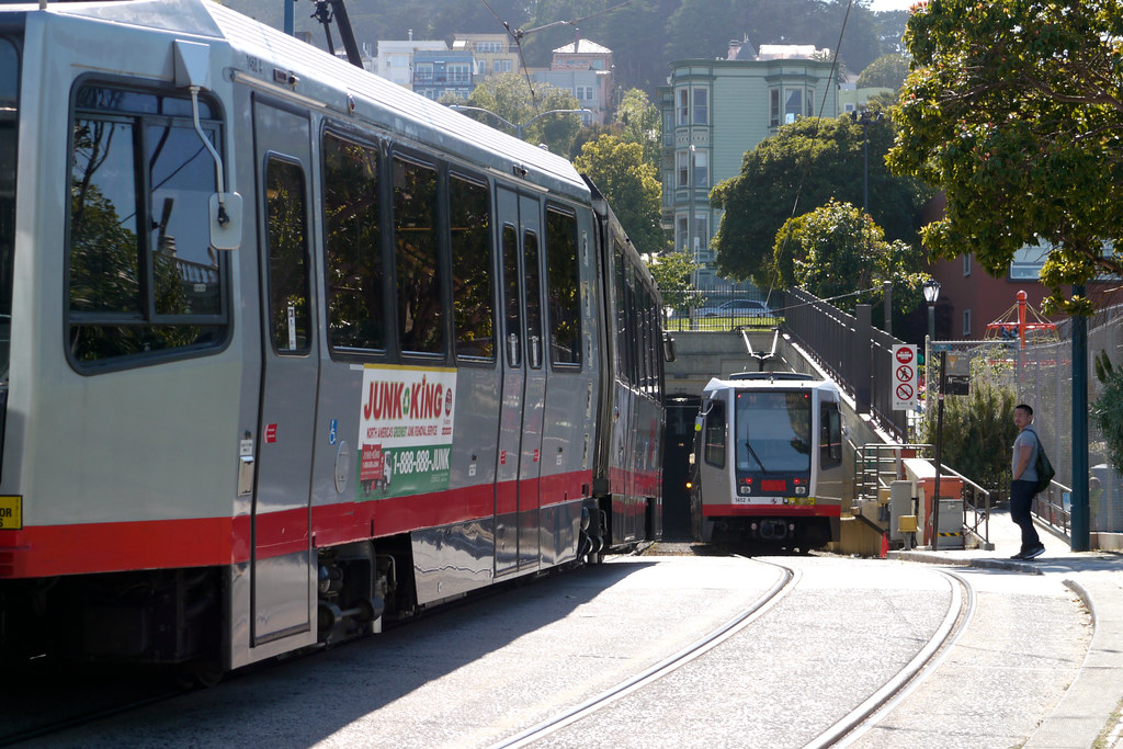 Two Muni trains at Duboce Park