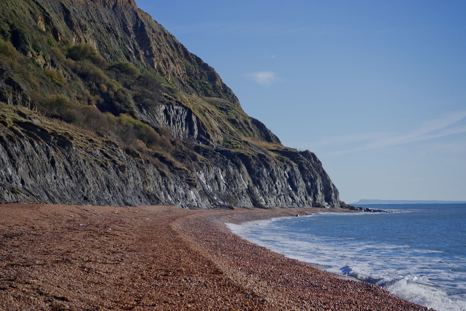 Cliff face looms over the beach at Seatown