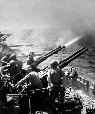 403px-40mm_guns_firing_aboard_USS_Hornet