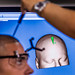 Researchers with the Non-Invasive Brain Stimulation (NIBS) Team calibrate the Brainsight Neuronavigation System to an Airman's head before attaching electrodes to administer directed electrical brain stimulation in the NIBS lab at the Air Force Research Laboratory, Wright Patterson Air Force Base, Ohio, Jul 19, 2016.  Researchers working in the NIBS lab, led by Dr. Richard A. McKinley, Ph.D., are exploring how directed electrical stimulation to the human brain affects cognition, fatigue, mood and other areas with the end goal of improving warfighter awareness, memory and focus. (U.S. Air Force photo by J.M. Eddins Jr.)