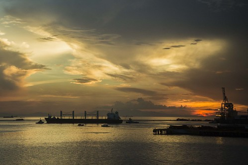 sunset sea sky leaving ship harbour philippines vessel cranes manila tugs