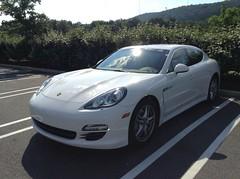 performance car(0.0), sports car(0.0), automobile(1.0), automotive exterior(1.0), executive car(1.0), family car(1.0), wheel(1.0), vehicle(1.0), automotive design(1.0), porsche(1.0), porsche panamera(1.0), rim(1.0), bumper(1.0), land vehicle(1.0), luxury vehicle(1.0),