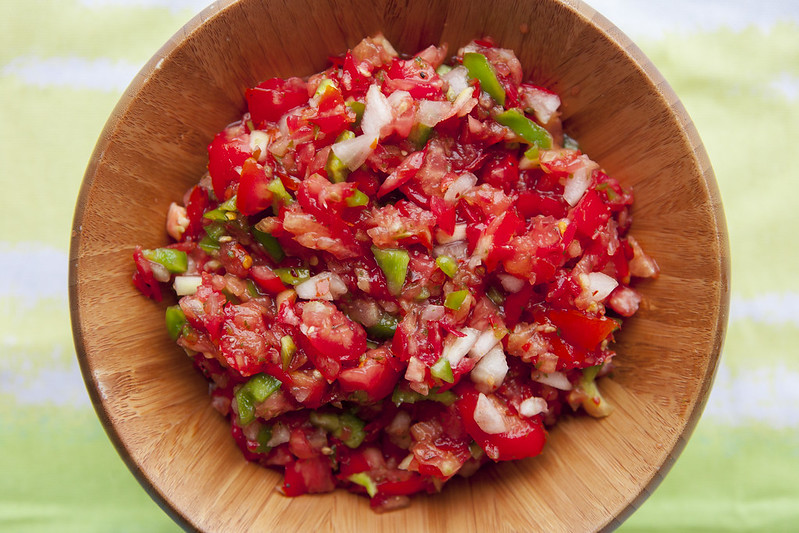 Vegetable Garden Salsa recipe using fresh ingredients straight from your garden! Friends beg for me to make this because it's that good! Ingredients are tomatoes, onion, green pepper, cilantro, salt + pepper and red pepper flakes!