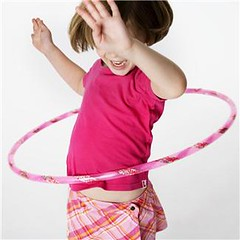 Little girl playing hula hoop