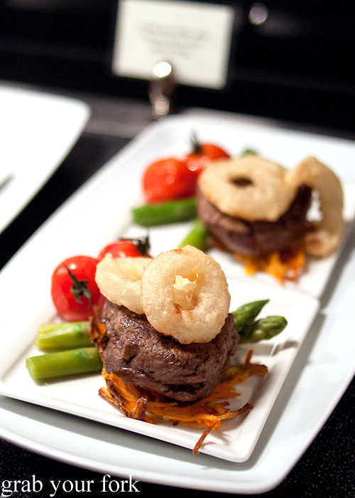 Steak on sweet potato roesti with onion rings at Emirates Business Class lounge, Sydney International Airport