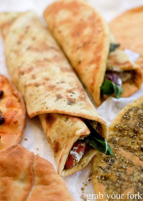 Saj and oregano pizza wraps with yoghurt, olive, tomato and mint at Charlie's Pizza, Canterbury