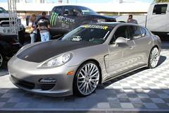 performance car(0.0), automobile(1.0), automotive exterior(1.0), executive car(1.0), family car(1.0), wheel(1.0), vehicle(1.0), automotive design(1.0), porsche(1.0), porsche panamera(1.0), rim(1.0), bumper(1.0), land vehicle(1.0), luxury vehicle(1.0), sports car(1.0),
