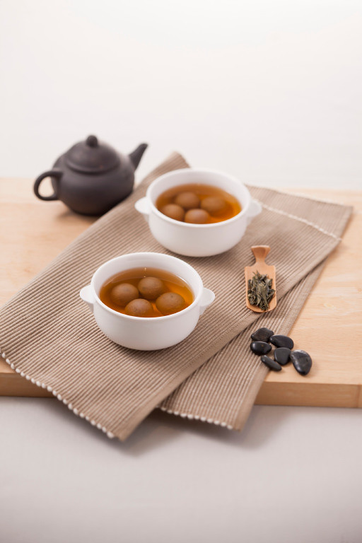 black glutinous rice dumplings  osmanthus in sweet ginger soup (bowl).jpg