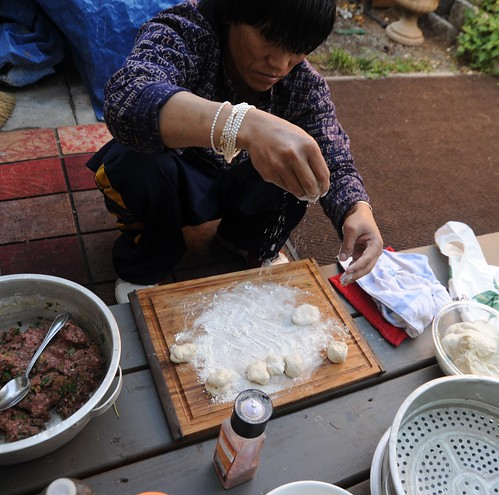 Carson making Tibetan mo-mos on the front porch, beef, a dusting of flour, Himalayan salt, steamer, napkins, Seattle, Washington, USA by Wonderlane
