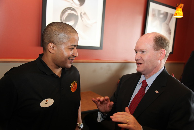 Senator Coons speaks with Eric Ames, owner of Zoup!
