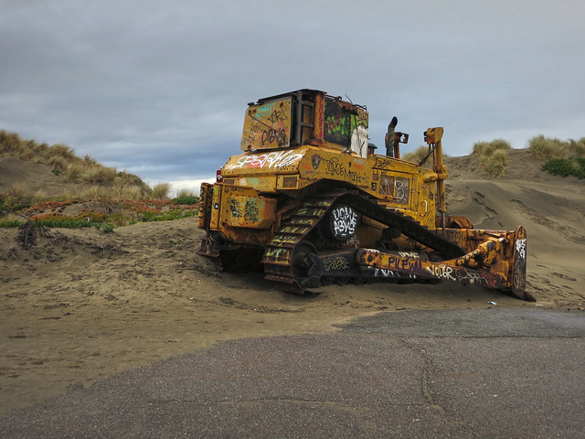 bulldozer, graffitied; Ocean Beach, San Francisco (2014)