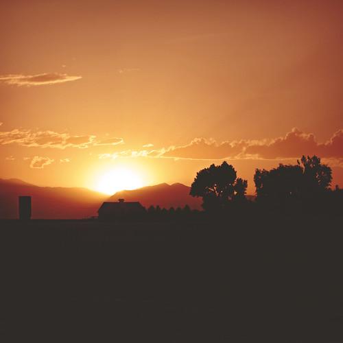 sunset sky orange sun sunlight house mountains tree beautiful silhouette clouds landscape photography colorado earth peaceful project365