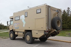 military vehicle(0.0), recreational vehicle(0.0), armored car(1.0), automobile(1.0), commercial vehicle(1.0), vehicle(1.0), truck(1.0), armored car(1.0), light commercial vehicle(1.0),