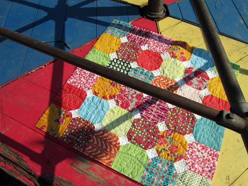 Clashy Bright baby quilt (in its element)