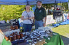 "Rick Olsen with daughter Kristin displaying products from ""Hands of Olsen."""