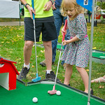 hmc019 -- During Family Fun on the Quad, 4-year-old Sophie Trucko tries mini-golf.
