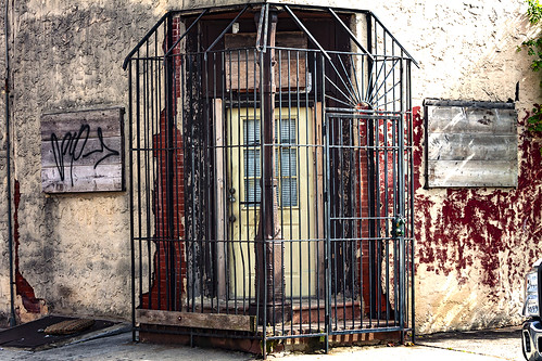 Caged-corner-entrance-at-5th-and-Mercy--South-Philly