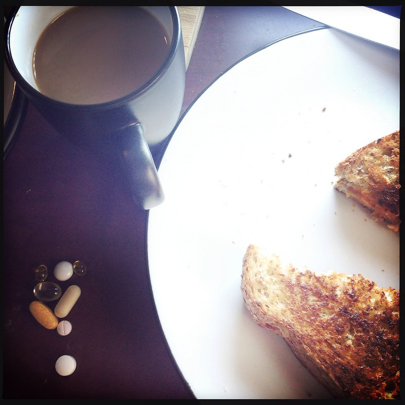 SAD lamp, toast, coffee, and vitamins